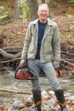 Archer Mayor with chainsaw